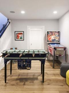 Foosball and Pinball area on lower level