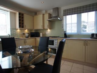 Bespoke fully fitted kitchen with dining area for six