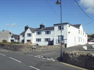 front showing garden and neighbouring Cemaes Bay lifeboat station