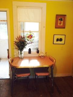 1940s dinette set serves as a breakfast table in the kitchen. Dining room/sitting area is behind it