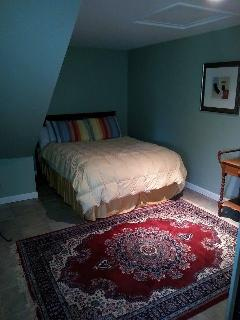 1st floor queen bed in open alcove