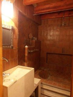 Bathrooms are elegant and have been built with fine materials, typical in mexican architechture.