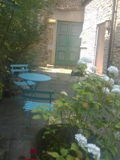 Table and chairs outside Cottage front door (on right of photograph.Green doors not used)