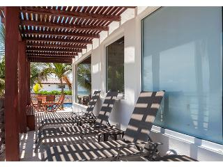 Private beachfront deck - black out shades down in guest bedroom