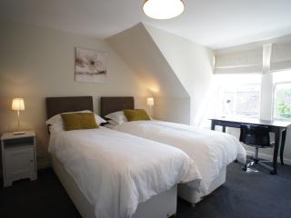Master bedroom with twin or double beds and en-suite shower room