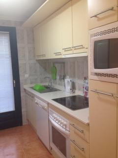 Good size separate kitchen with outside patio utility space