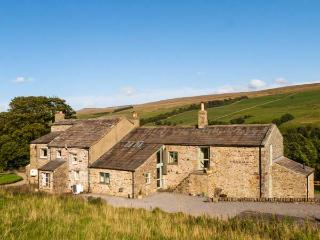 DEERCLOSE WEST FARMHOUSE, stone-built, woodburners, parking, garden, in Horsehou