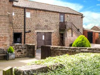 THE GRANARY, stone-built cottage annexe, on working farm, romantic retreat, near