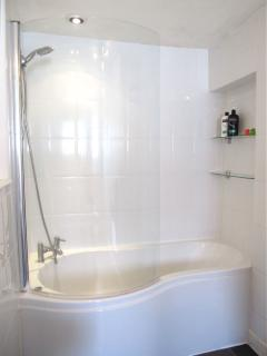 Shower over P-shaped bath