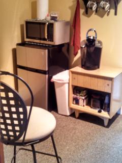 Mini frig, microwave, keurig coffee maker & other kitchen essentials.  Coffee and tea provided.