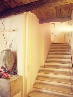 Stairs to the 1st floor where bedroom is located