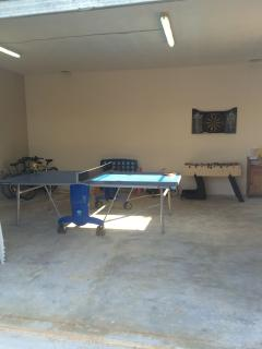 Games room equipped with ping pong, table football, darts, pool toys, board games