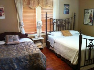 Large Bedroom 2 with one queen bed and one full bed. Lots of windows for natural light.
