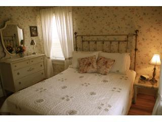 Queen bedroom upstairs with brass bed, antique furnishings and en suite bathroom with jacuzzi bath