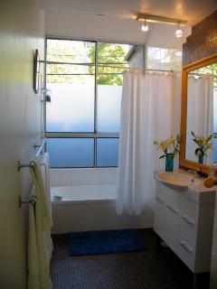 Bathroom adjacent to second bedroom on first floor