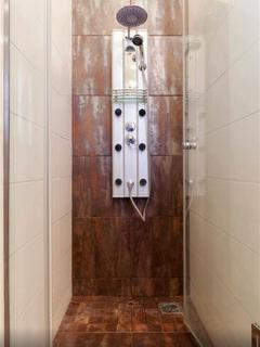 bathroom with massage shower