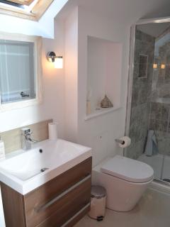 Immaculate luxurious en-suite with spacious walk in shower, & thoughtful directional lighting