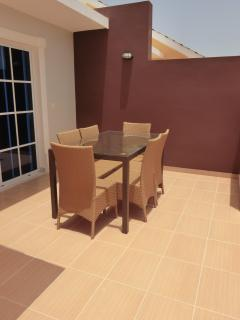 Upper level front balcony with dining area for 6