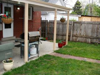 Back yard with a grill and covered patio