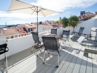 The terrace bathes in sun and has almost 180 degree view of Lisbon