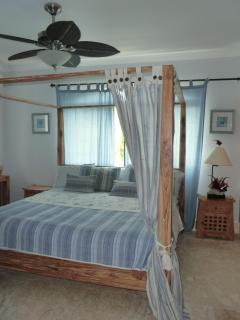 Master bedroom with romantic 4 poster king size bed