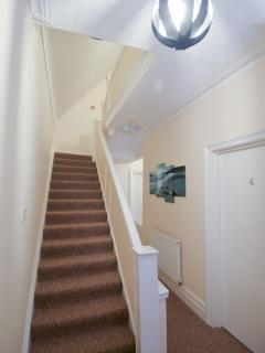 First floor landing with stairs to second floor