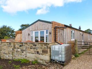 THE OLD PIGGERY, single-storey, detached wooden cabin, en-suite, WiFi, hot tub,