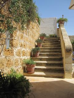 Original Stone Staircase from pool deck up to Shaded and sun terraces