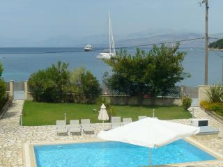 Avlaki beachfront villa with pool in Kassiopi