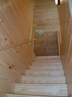 Hardwood steps leading to loft.