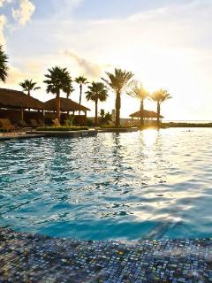 Enjoy the sun rising over our pool