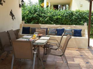 Dine al fresco on the patio overlooking the pool and gardens.