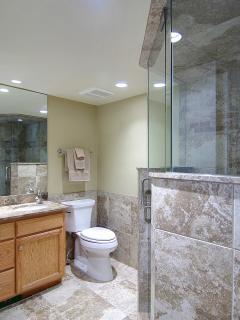 Master Bath has an walk in glass/tile shower WITH AN RAIN head out of the Ceiling WOW