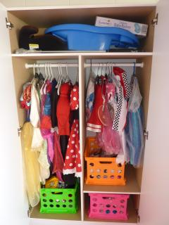 Dress up closet in games room, next to toy cupboard for younger children
