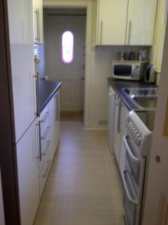 Well equipped galley kitchen, including cooker, dishwasher and washing machine