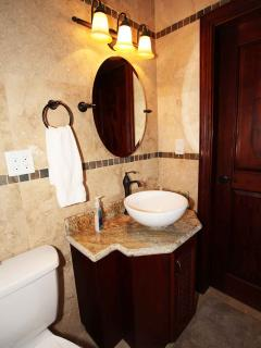 One of the three bathrooms found in the villa - complete with shower