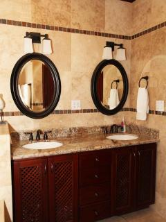 Master bathroom with travertine tile everywhere, shower, jetted tub, twin sinks...very luxurious!