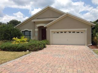 Beautiful 4 Bed 3 Bath pool home in a gated resort community.