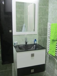 Bathroom with glass sink.