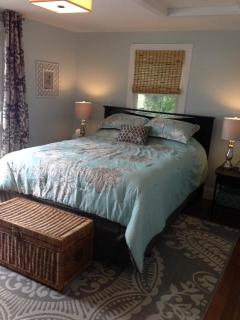 2nd Bedroom with queen bed and sliders out to private waterfront deck and flat screen TV.