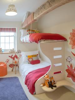 Cool kids bunk room with original artwork and pullout truckle bed if needed.