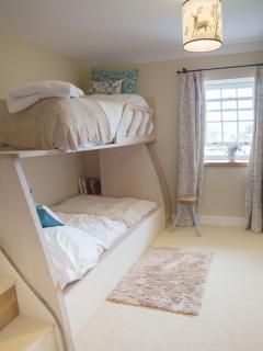 With extra wide & extra long luxury mattresses this adult bunk room is stylish & so comfortable.