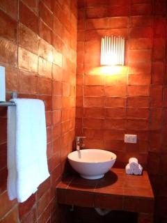 The bathroom of the second bedroom is also built with mexican materials and style.