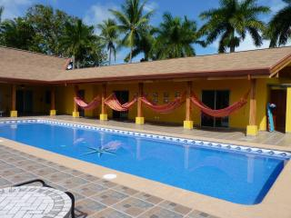 hammocks & pool side entrance to guest rooms