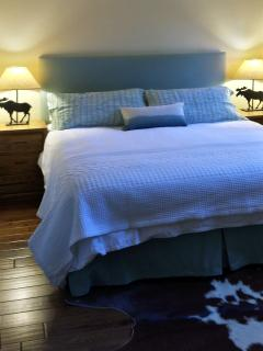White soft linens await you at the end of the day on this very comfy King bed