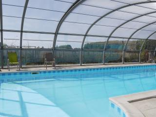 12m heated pool, with cover and opening sides