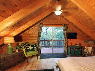 Upstairs King Bedroom view from bed towards balcony and tree tops