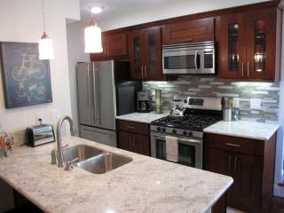 The bright, well-equipped kitchen features a gas stove and breakfast bar.