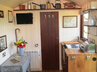There's a proper fitted kitchen with oven, hob, sink, fridge, dining table and stools.