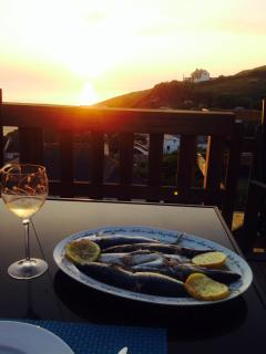 Enjoy a meal and a glass of wine on the deck